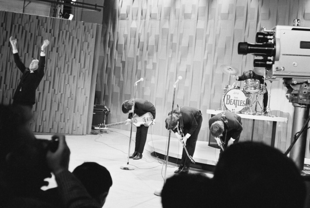 The Beatles bowing on the Ed Sullivan Show; an act instilled in them early by manager Brian Epstein.
