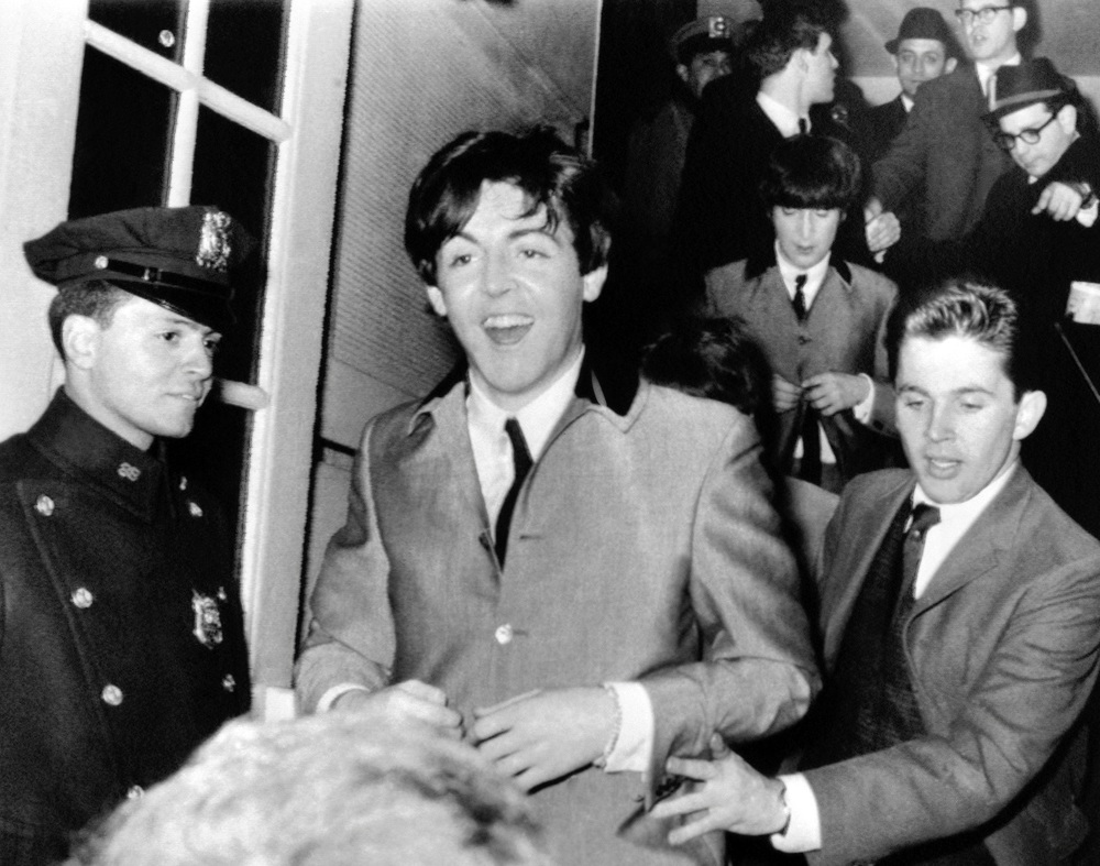 Paul McCartney and John Lennon leaving Carnegie Hall, February 12th 1964.
