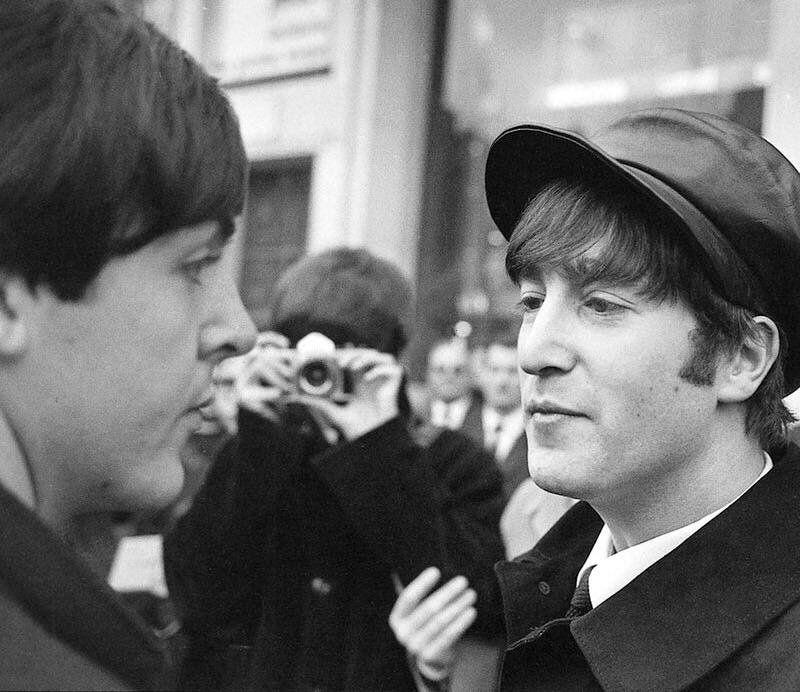 John Lennon, George Harrison and Paul McCartney in Paris, 1964.