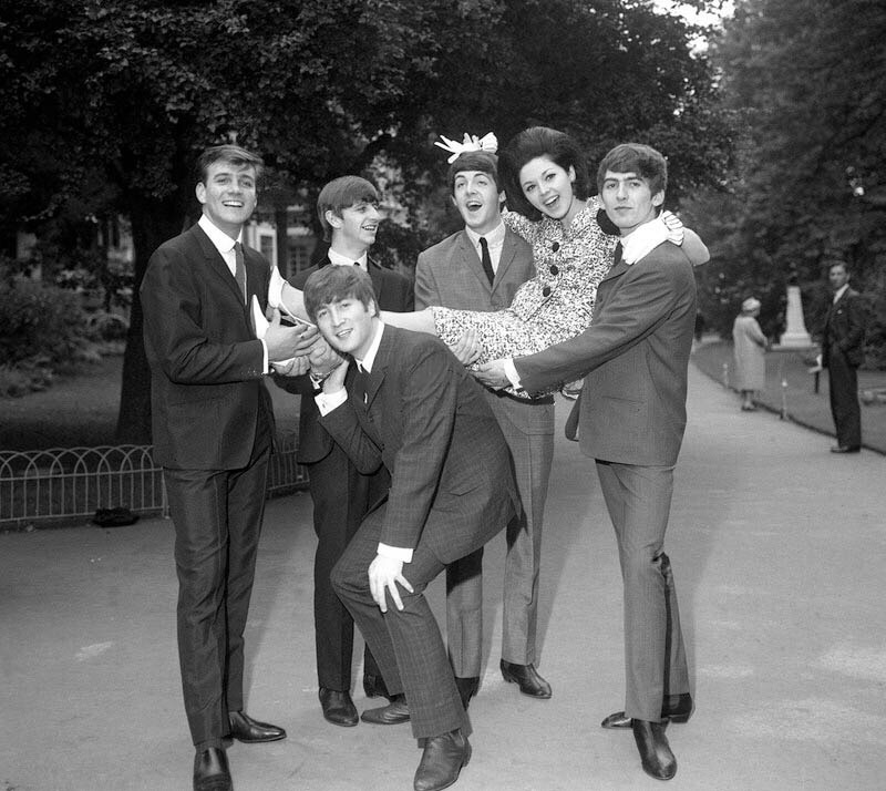 The Beatles celebrating their Melody Maker Top Vocal Group Award with Susan Maughan, September 10th 1963.