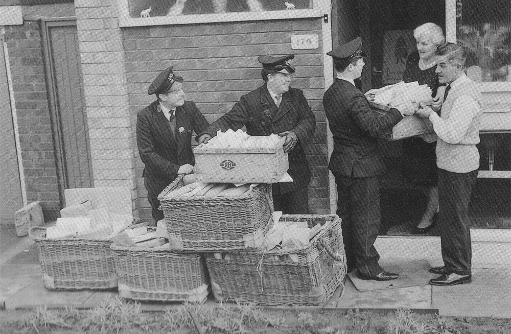 George Harrison's parents accepting a delivery of cards for their son's 21st birthday, February 25th 1964.