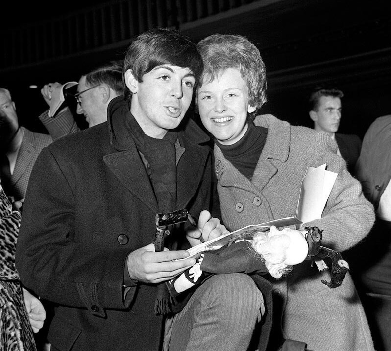 Paul McCartney with one lucky fan, 1963.