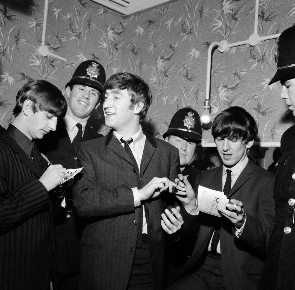 John, George and Ringo sign autographs for Birmingham police.