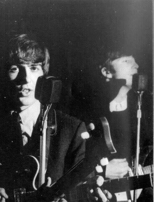 John Lennon and George Harrison, circa 1962.