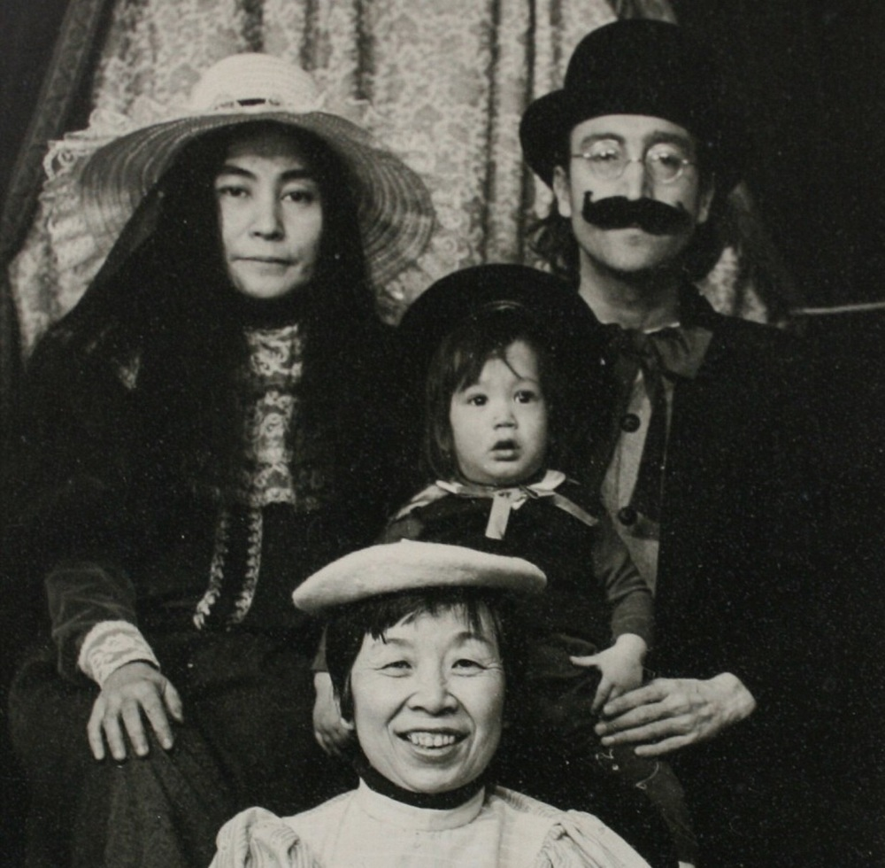 John Lennon with Yoko, Sean and Sean's minder dressed in 19th century clothing in Massachussets, 1977.