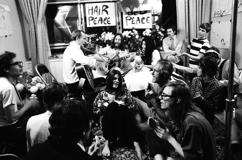 John Lennon, Yoko Ono et al performing Give Peace a Chance at the Queen Elizabeth Hotel, Montreal, Quebec, Canada, June 1st 1969.