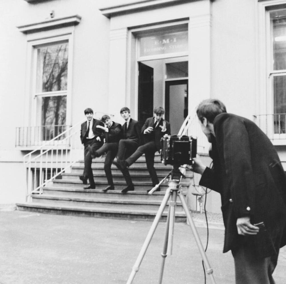 The Beatles photographed leaving EMI Studios, 1963.