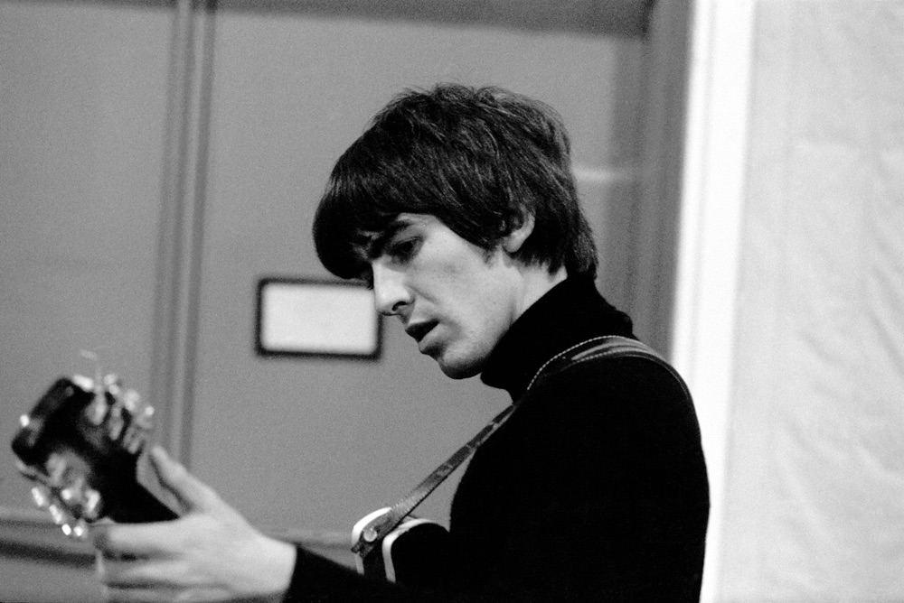 George Harrison during a Beatles for Sale recording session, 1964.