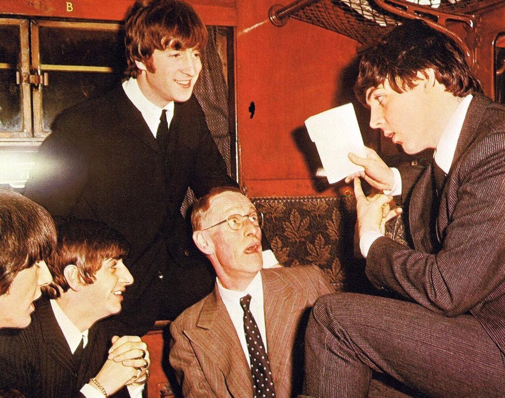 The Beatles with actor Wilfrid Brambell, 1964.