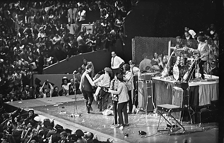 The Beatles getting mobbed by fans at the Cow Palace, San Francisco, August 31st, 1965.