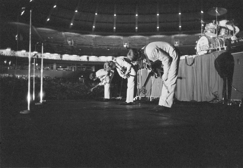 The Beatles bowing at DC Stadium, August 15th 1966.