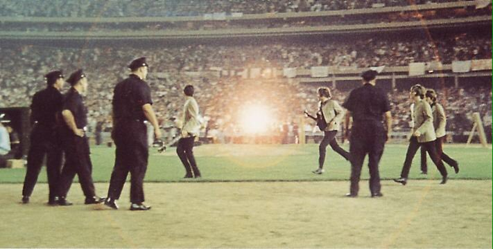 The Beatles make their way to the stage at Shea Stadium, August 15th 1965.