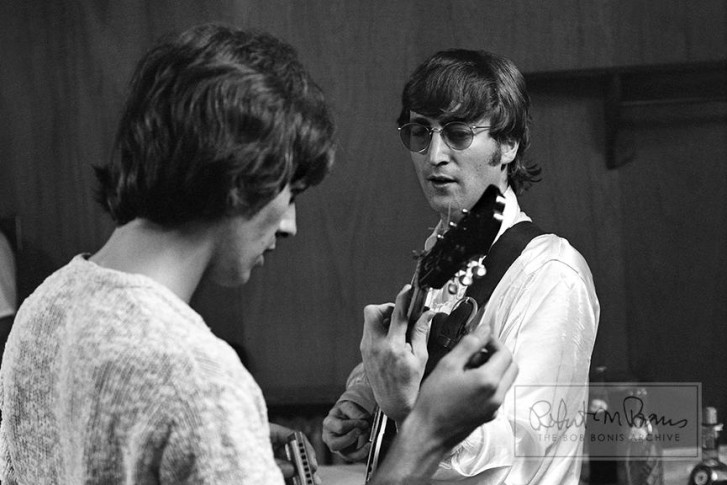John Lennon and George Harrison backstage at John F Kennedy Stadium, August 16th 1966. Photo by Bob Bonis.