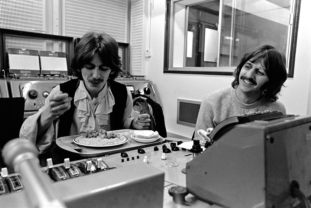 George Harrison and Ringo Starr take a break during the recording of the White Album, 1968.