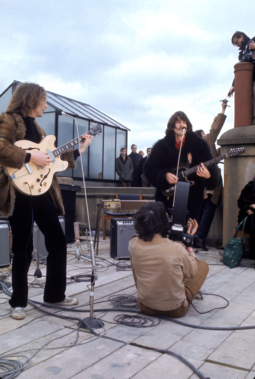 John Lennon and George Harrison on the rooftop of Apple Headquarters, 3 Saville Row, January 30th 1969.
