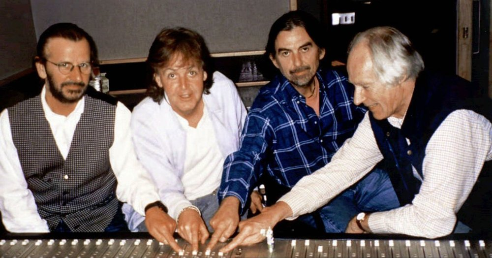 Ringo Starr, Paul McCartney, George Harrison and George Martin working on the Anthology project, circa 1994.