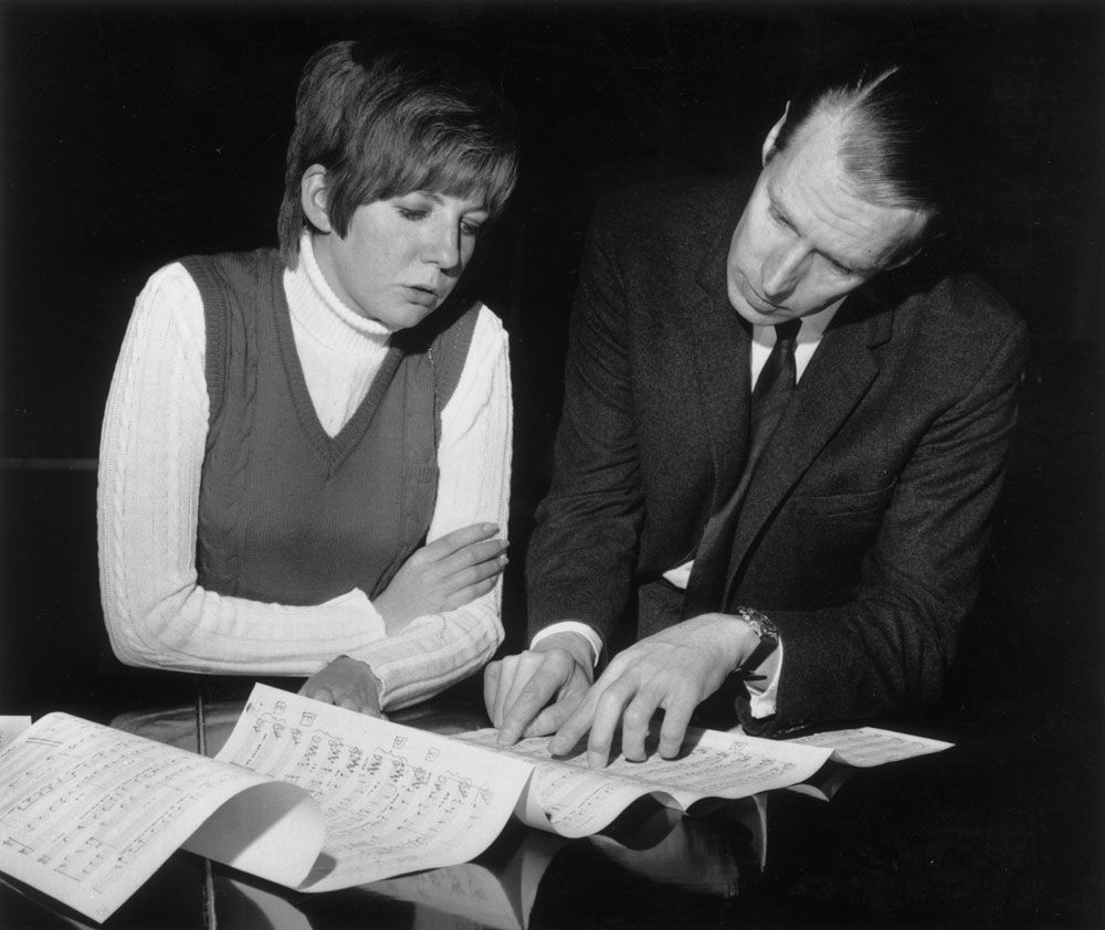 Cilla Black with Beatle producer George Martin.