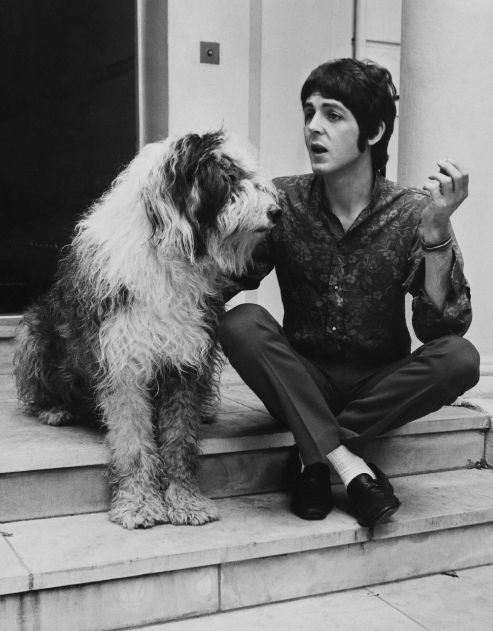 Paul McCartney with his sheepdog Martha, 1968.