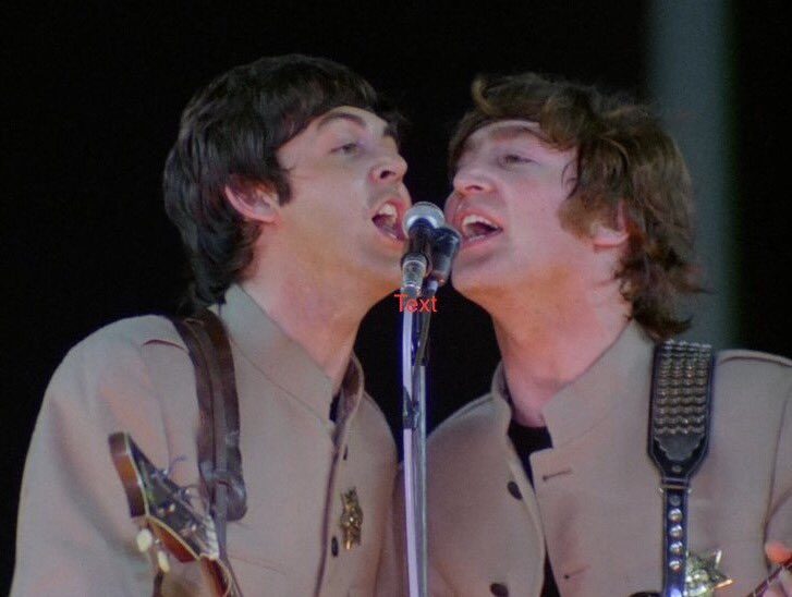 Paul McCartney and John Lennon at Shea Stadium, August 15th, 1965.