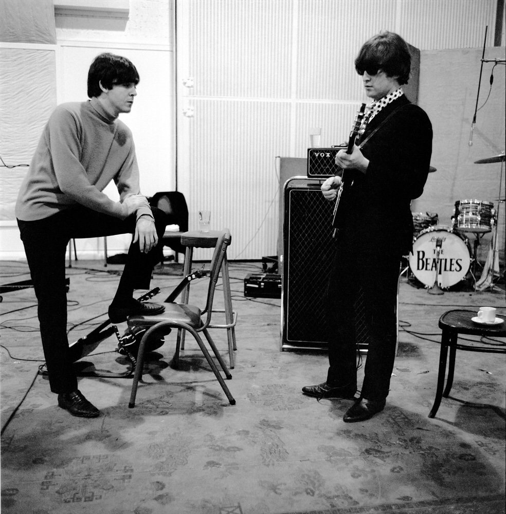 Paul McCartney and John Lennon rehearsing at Abbey Road, 1964.