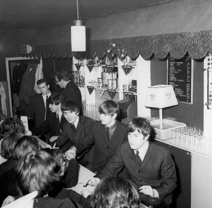 The Beatles signing autographs at the Wimbledon Palais, London, December 14th 1963.