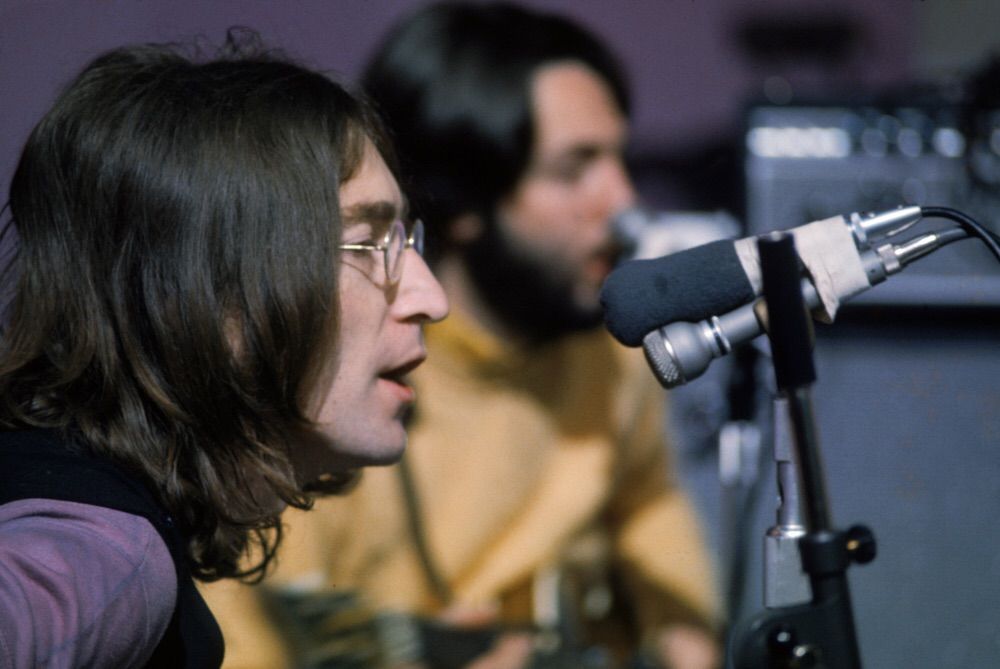 John Lennon and Paul McCartney during a Let It Be session, 1969.