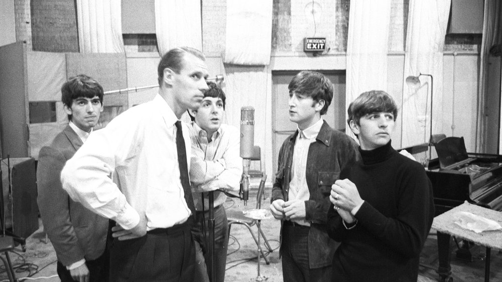 The Beatles at Abbey Road with producer George Martin, circa 1964.