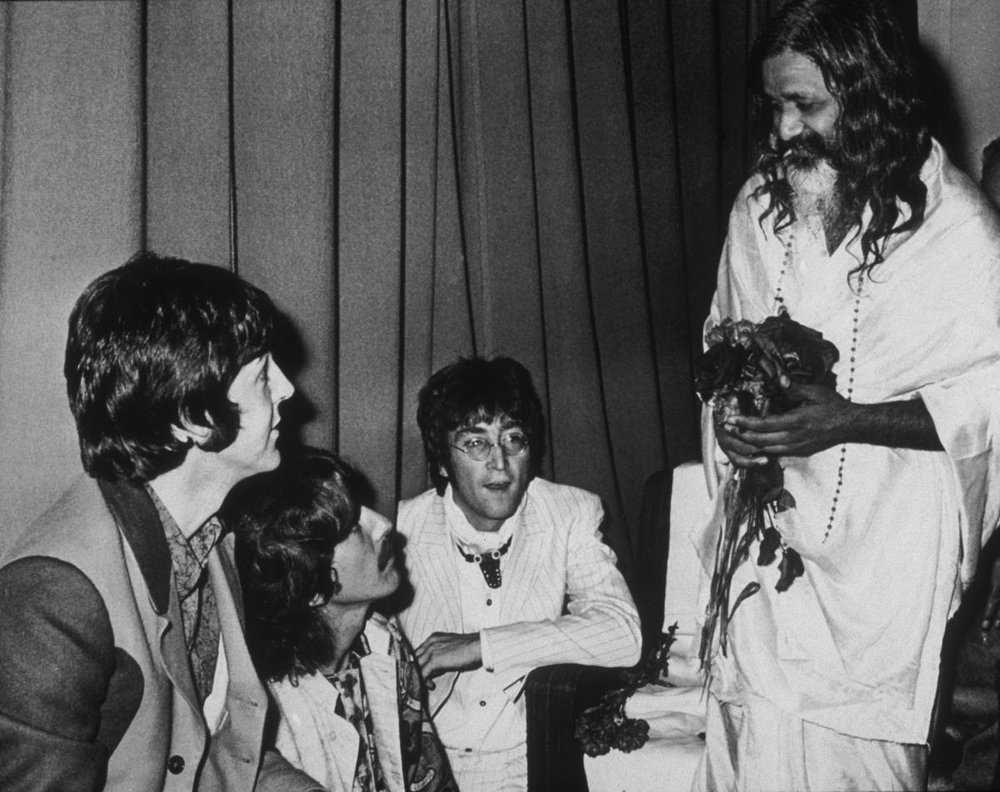 Paul McCartney, George Harrison and John Lennon with Maharishi Mahesh Yogi, 1967.