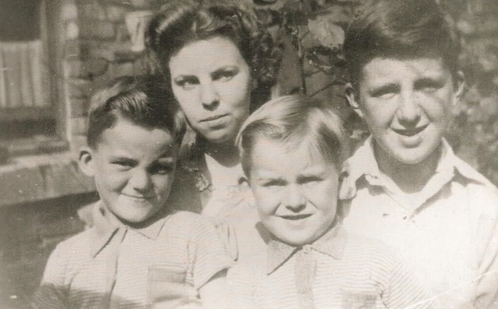 George Harrison (bottom right) with his brothers Peter and Harry and sister Louise.