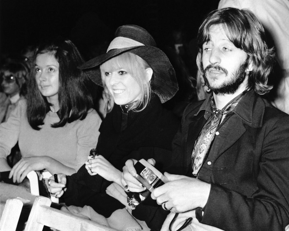 Ringo and Maureen Starkey watch Bob Dylan perform at the Isle of Wight festival, August 31st, 1969.