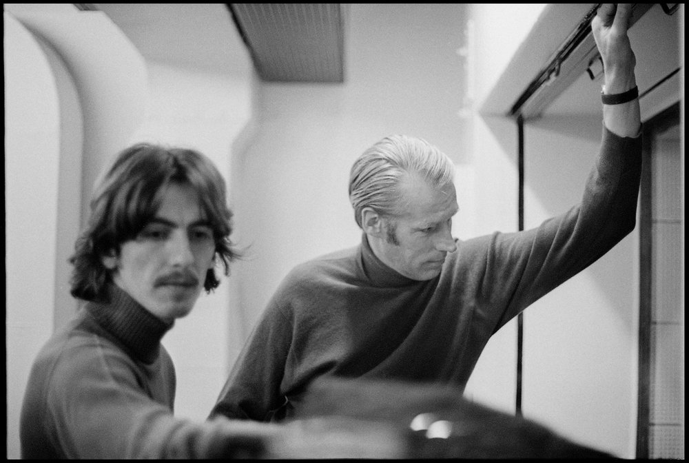 George Harrison and George Martin during  a White Album session, 1968.