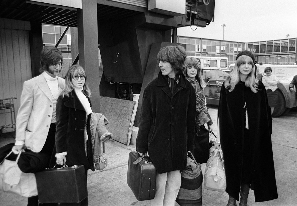 From left to right: John & Cynthia Lennon, George Harrison, Jenny & Pattie Boyd leaving for India, February 15th 1968