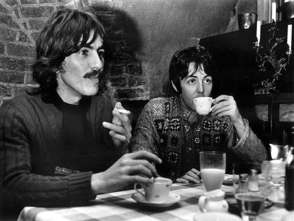 George Harrison and Paul McCartney taking a break from filming Magical Mystery Tour, 1967.