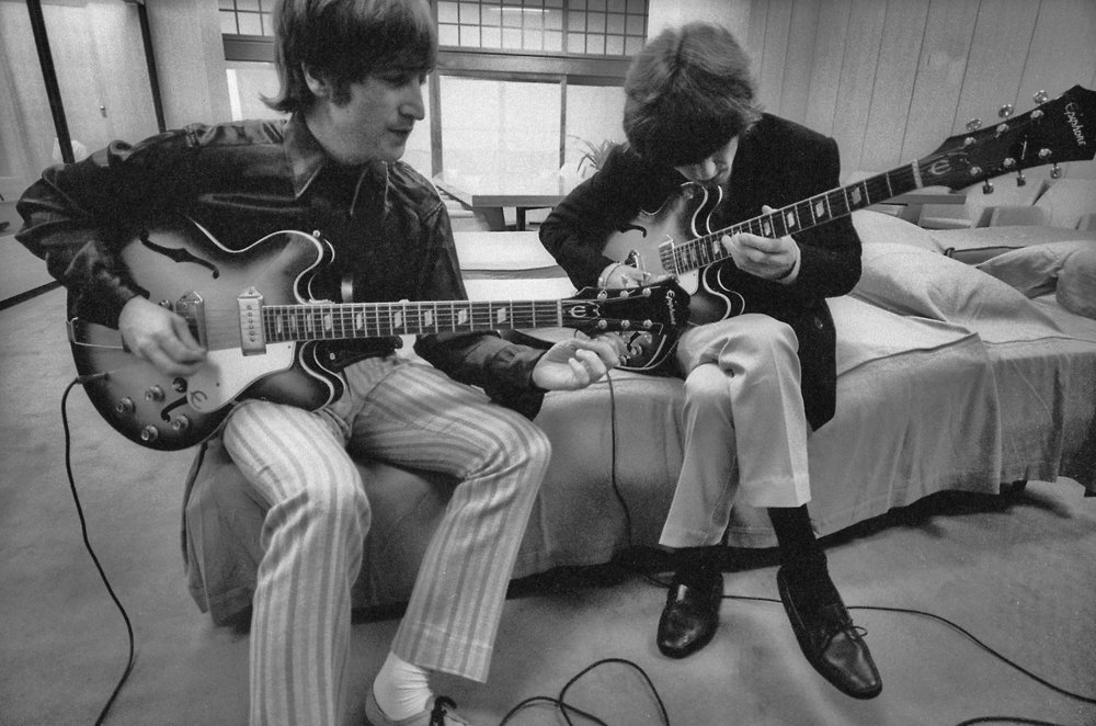 John Lennon and George Harrison backstage at the Budokan Hall, Tokyo, June 1966.
