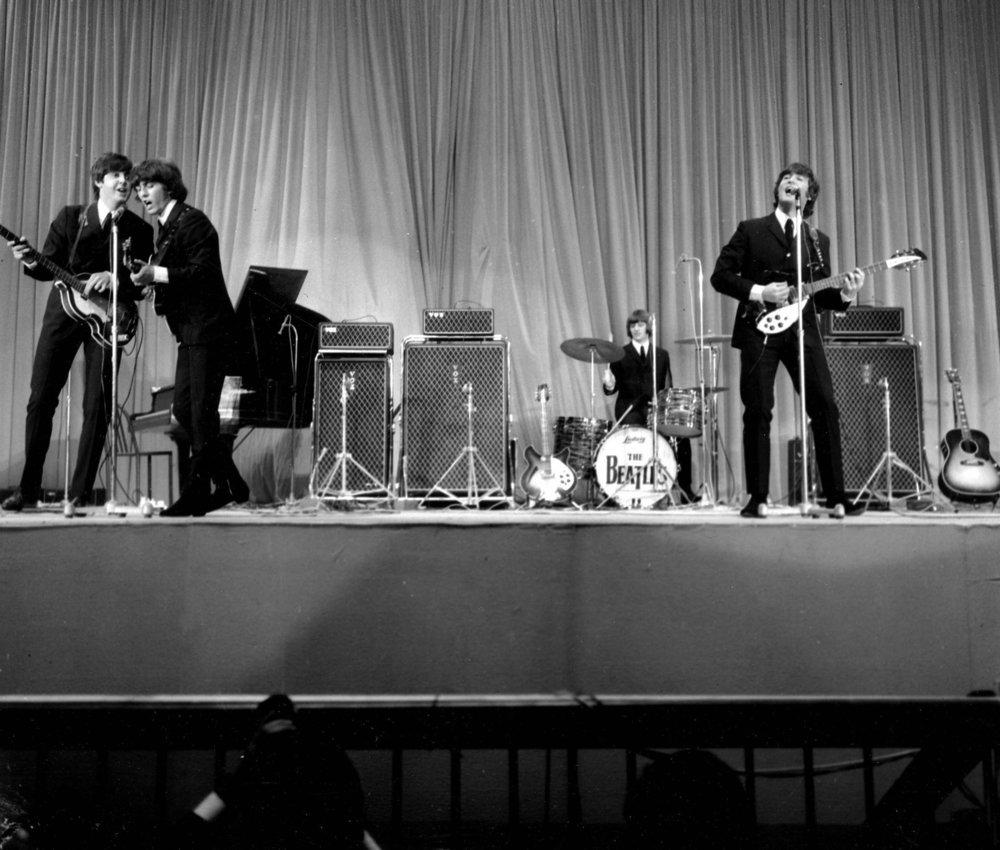 The Beatles on stage at the Palais des Sport, Paris, June 20th 1965.