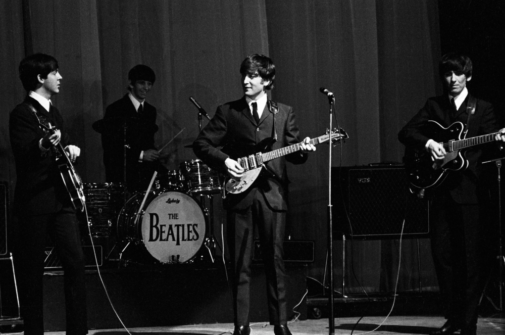 The Beatles perform at the Olympia Theatre, Paris, January 1964.