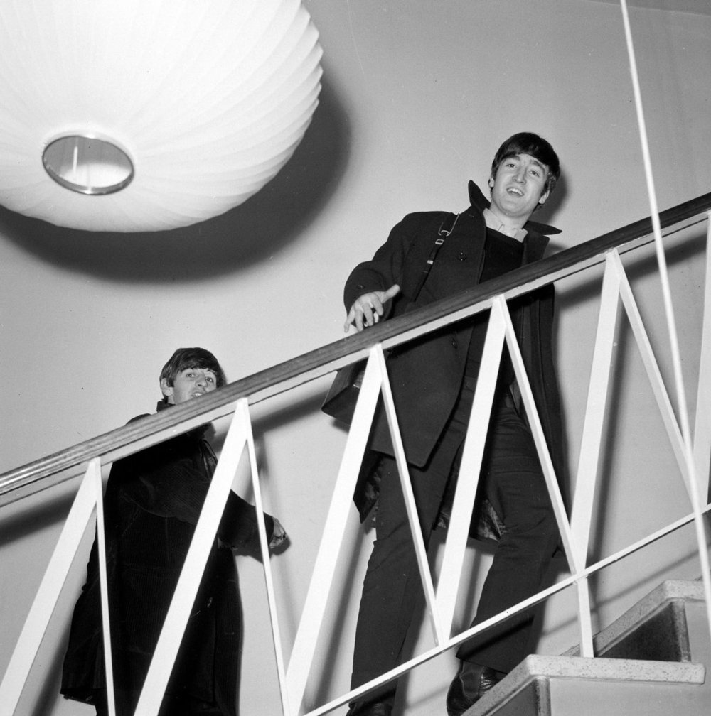 Plymouth 13th November 1963. John Lennon and Ringo Starr climbing the stairs