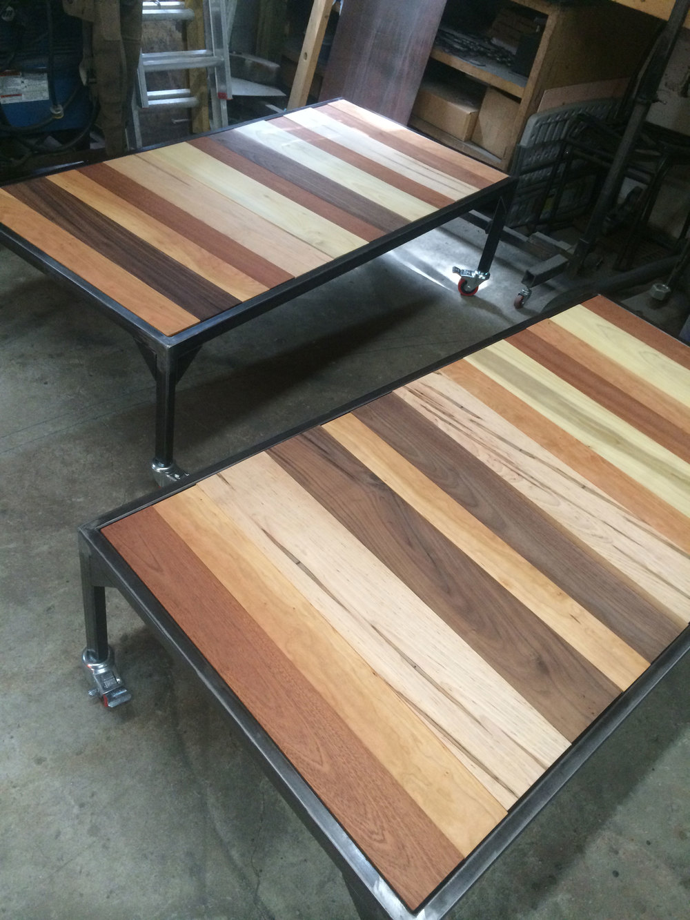 Steel and wood display tables