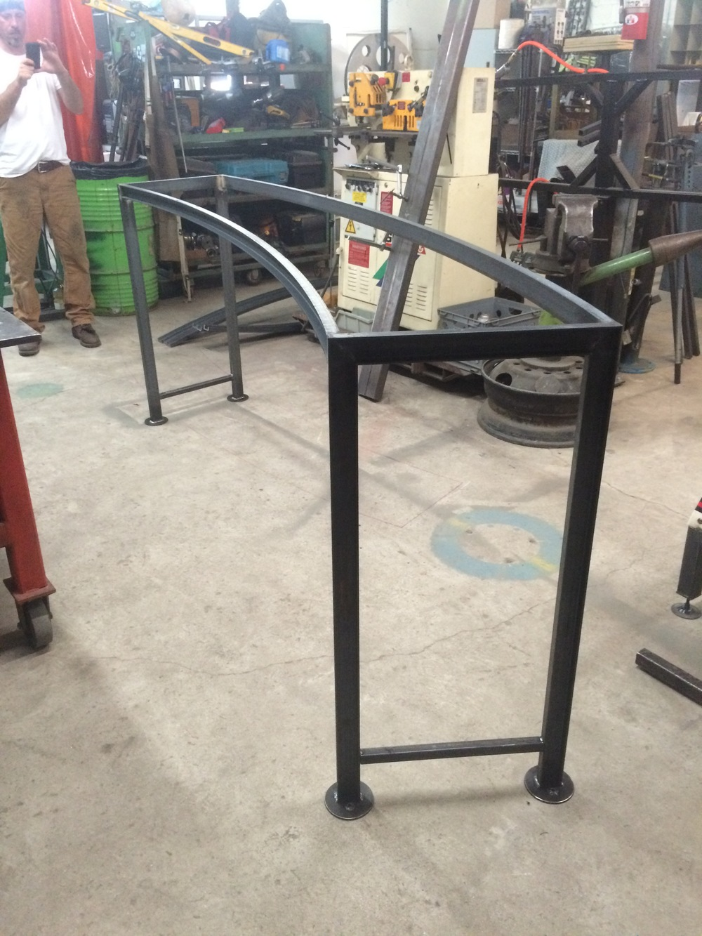Custom steel arc tables
