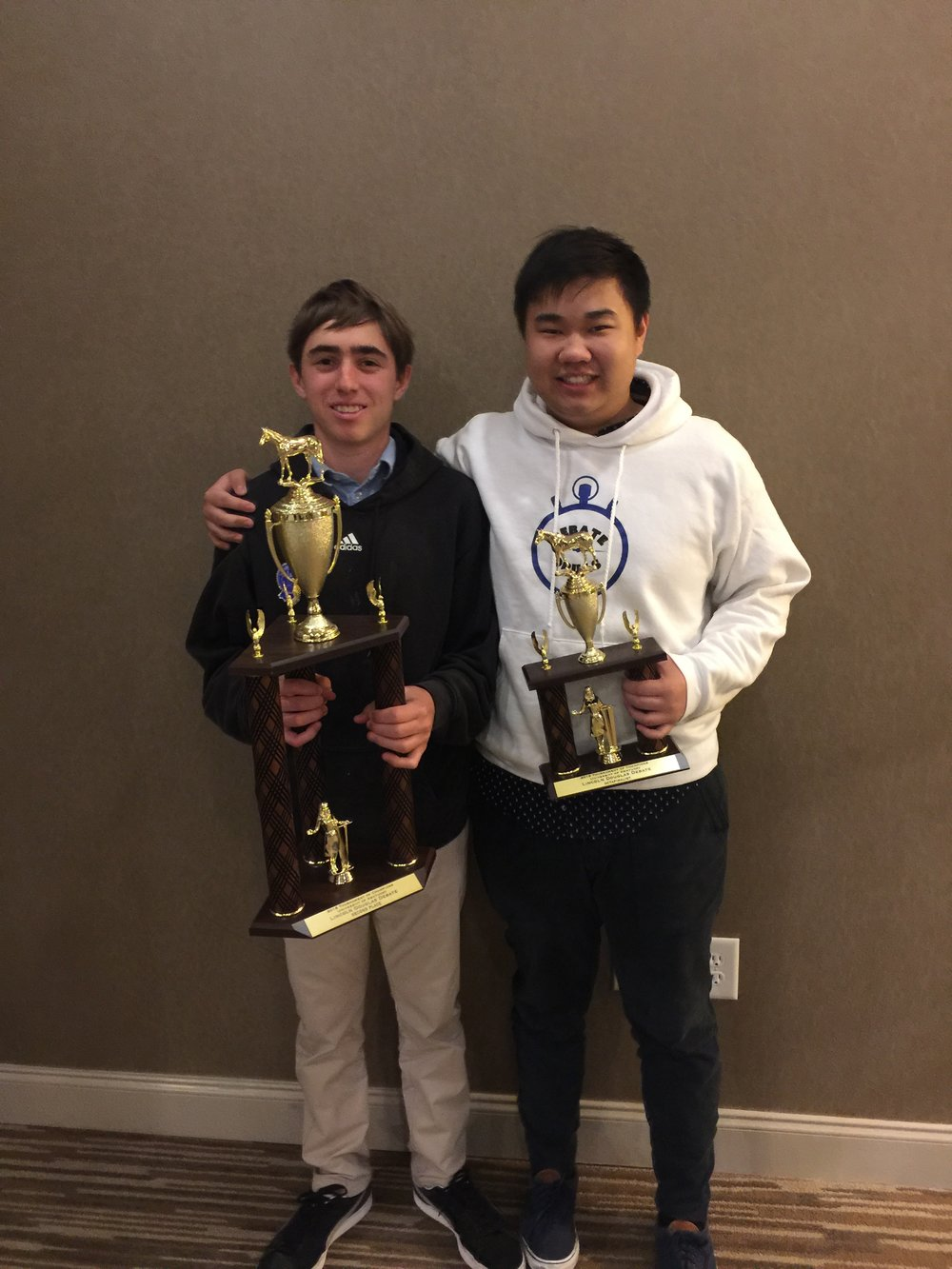 Debatedrills' students Rex Evans (Finalist) and Eric Deng (Octofinalist) celebrate a successful 2018 TOC.