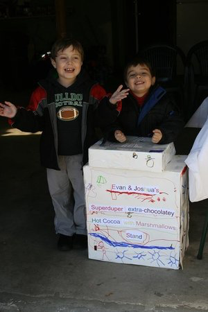 evan, 5, and joshua, 3, at the first hot cocoa stand