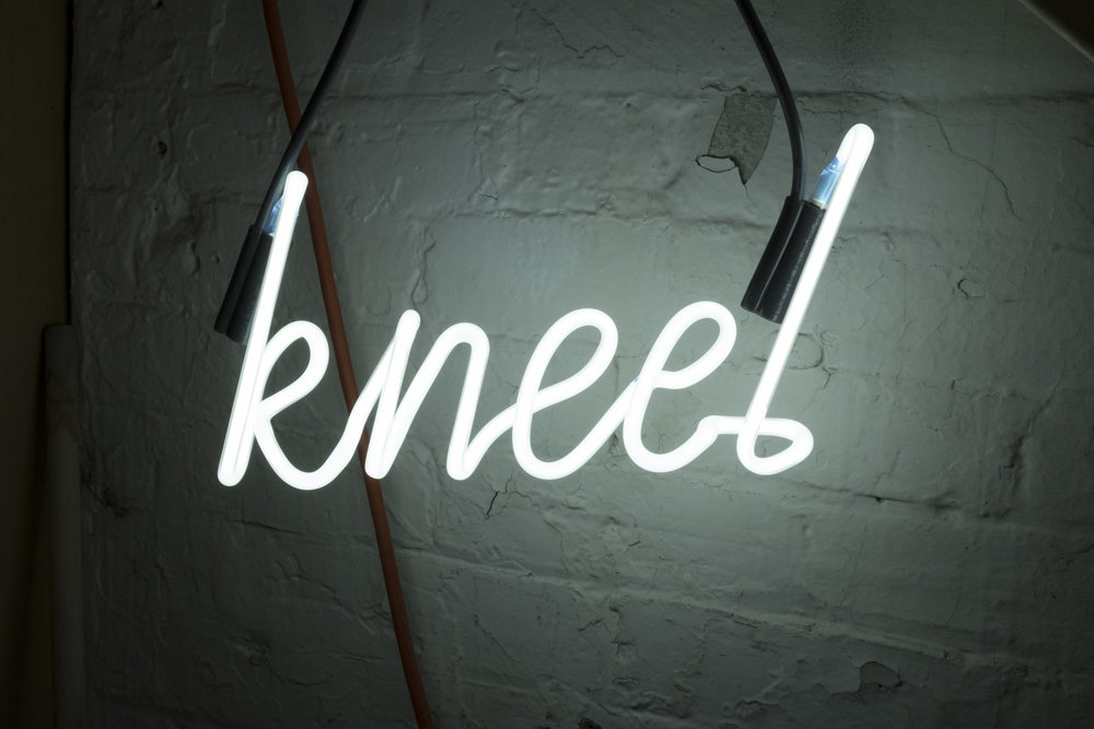 Kneel , 2018 – neon detail Mixed media; neon, glass, resin, readymade, tape; dimensions variable. Photographed by Brittany Carmichael.