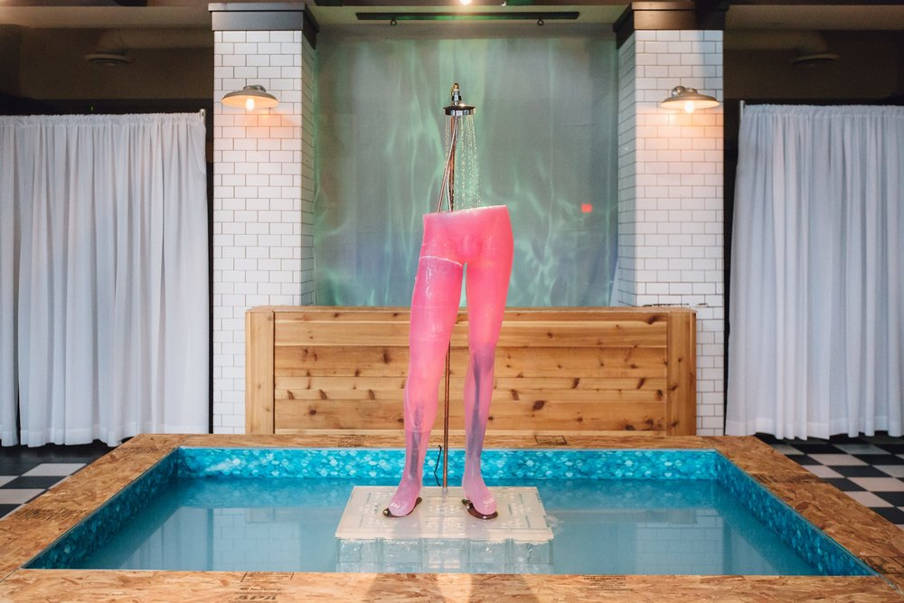 """David  central component of  PInk Champagne , 2018. [Working fountain] tinted glycerine, swimming pool vinyl, water, chip board, glass, acrylic, copper pipe and plumbing fixtures, steel, silicone, pump. 144x120x96"""". Photo documentation by Diane and Mike Photography, and Keeghan Rouleau."""