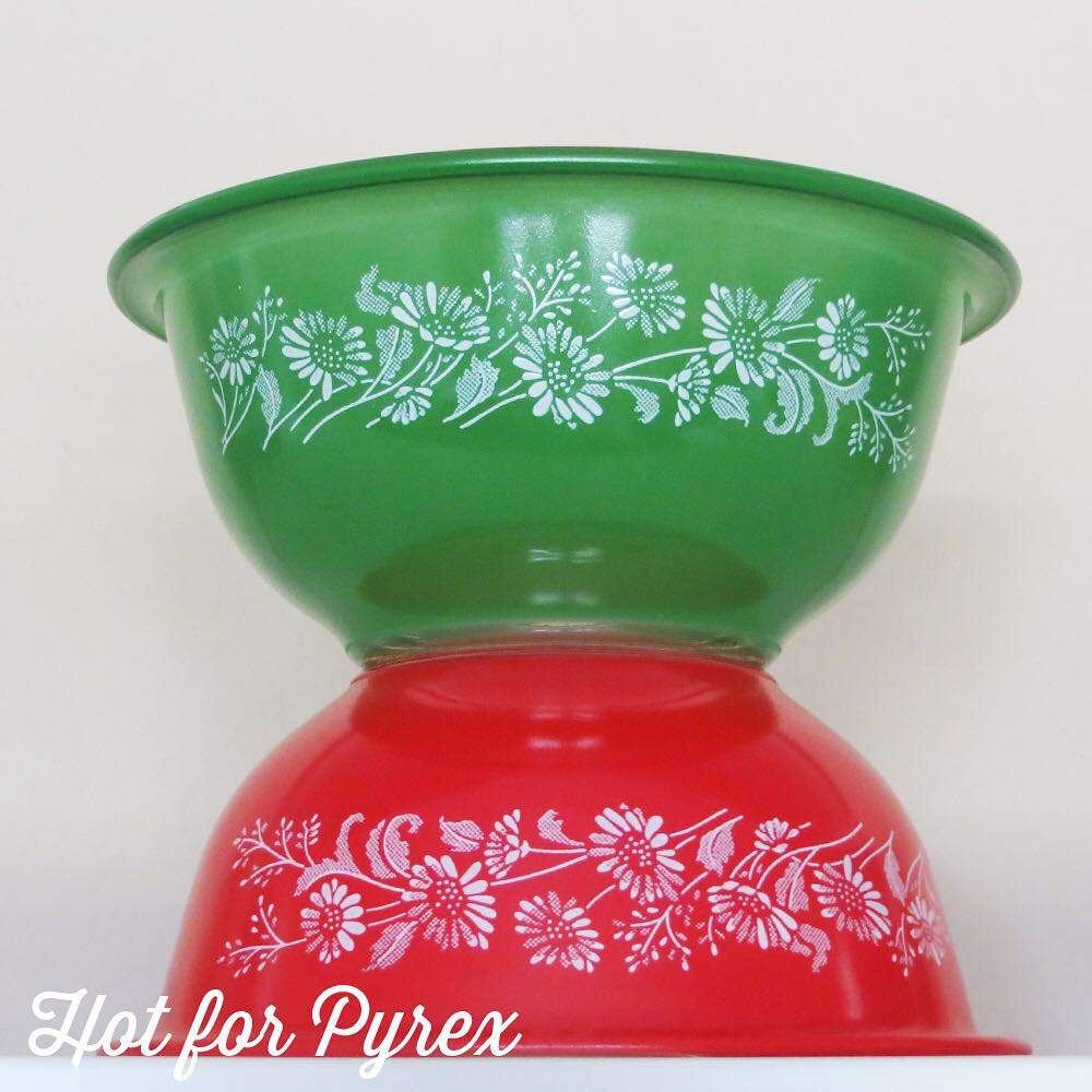 Day 22 of 100 - I love beloved pyrex patterns found on new shapes and colors. Here, the delicate white colonial mist pattern is found on vibrant red and green clear-bottom bowls. #100hfp #hotforpyrex #rarepyrex #rarepyrex #htfpyrex #pyrexaddict #vintagepyrex #love #cmog #pyrexlove