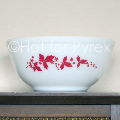 "I promised myself I wouldn't start collecting English Pyrex.  I told myself, ""You don't have the room,"" ""You can't afford to ship heavy glass across the Atlantic,"" ""It is disloyal to the American Pyrex I already own.""  Well, none of those arguments worked and I am the proud owner of a Red Hawthorn JAJ Pyrex mixing bowl.  It is approximately the same size as a US 403.  I haven't been able to find much about this piece online, but I do know that the red version is a more difficult to find color."