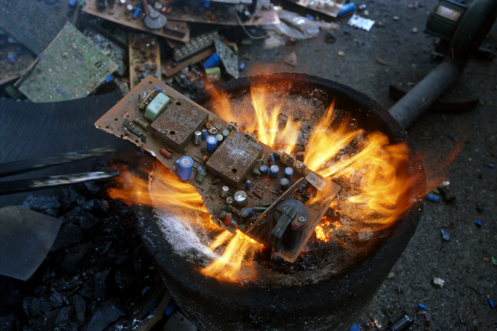 Burning a circuit board over an open fire release dioxins and furans
