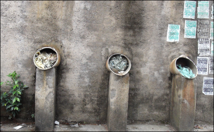 Cut chimneys where formerly e-waste laborers cooked circuit boards inside houses in Guiyu. Copyright BAN 2015.