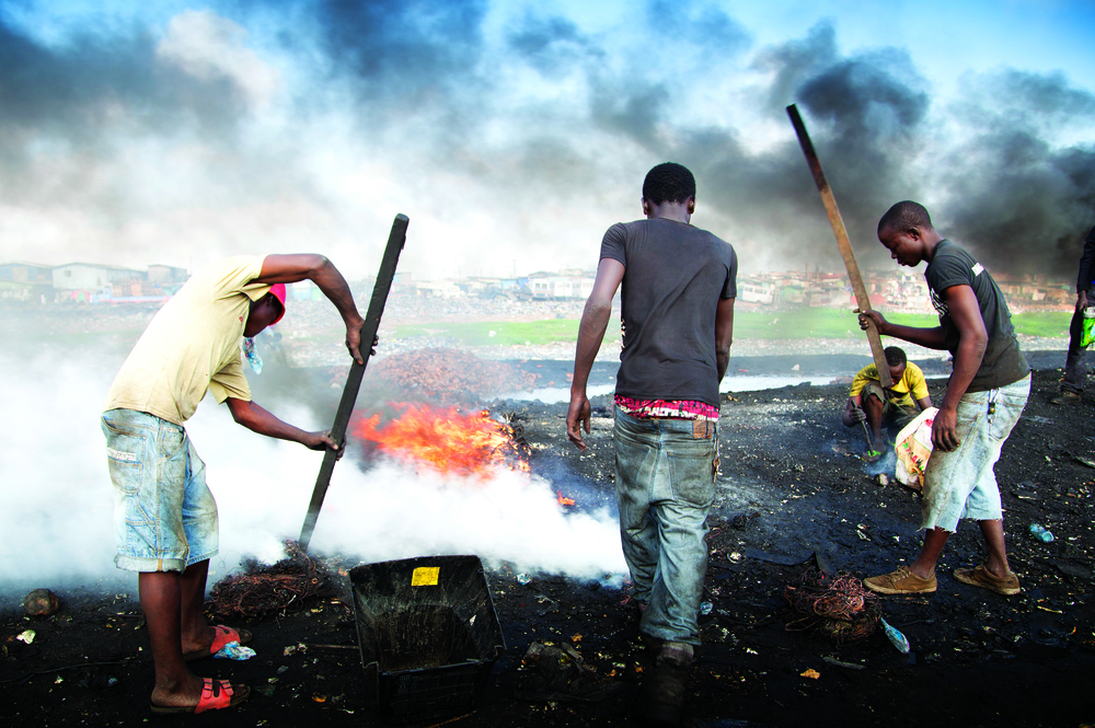 In Ghana, boys burn wires to extract copper.