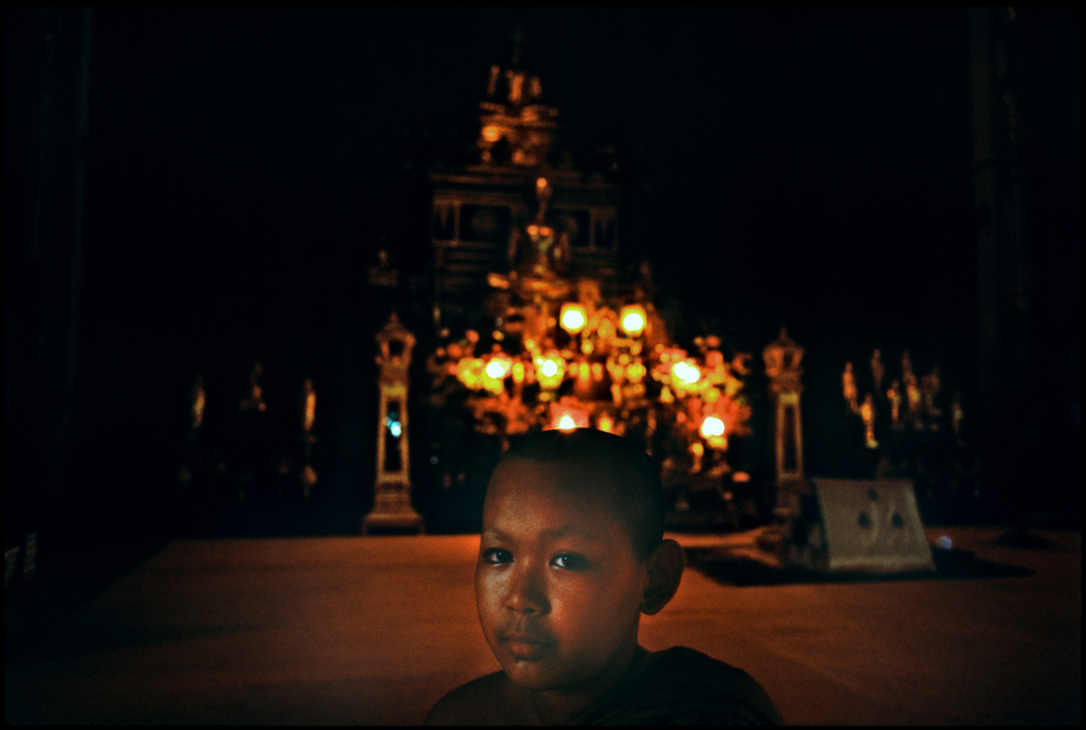 A boy in temple. Bangkok, Thailand.