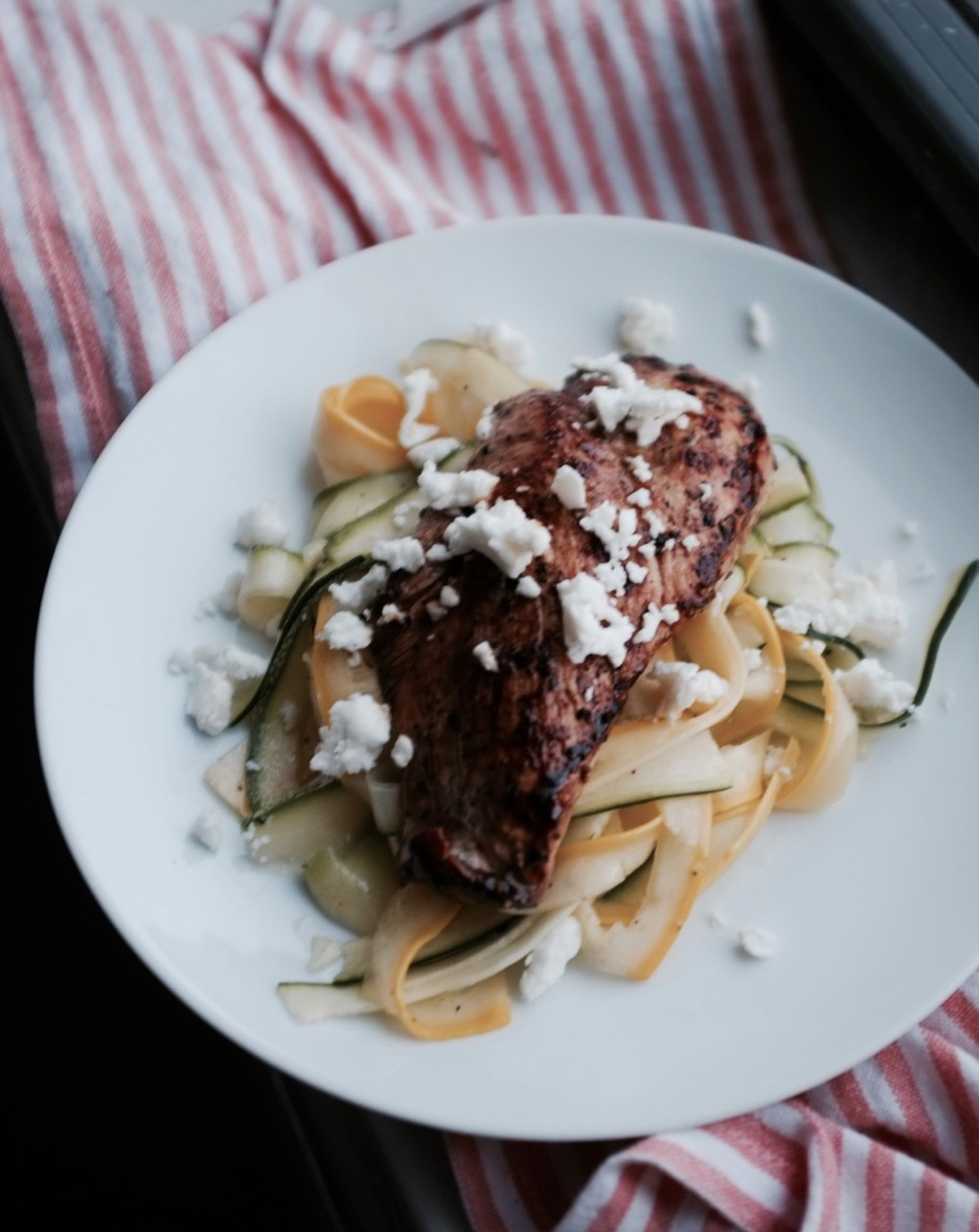The most delicious, simple late summer dinner. Shave squash with a vegetable peeler, toss with oil and salt and then top with a quickly marinated chicken breast. Top with crumbled feta--voila!